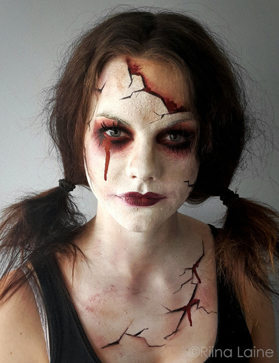 Broken doll. Face painting: Riina Laine