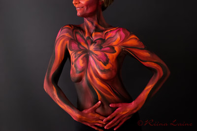 Body painting with model's empowering colours | Body painting & photo: Riina Laine